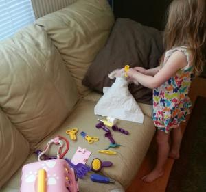 """Playing dentist (note the burp cloth """"bib"""" on her bunny, just like the one at the real dentist)"""