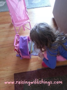 Getting her bag (with books in it!) ready for a trip to the park