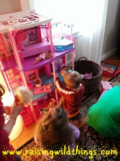 Playing dinosaurs in Barbie's house!
