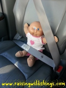 Even our dolls ride safely. (Also, that is my Cabbage Patch doll from when I was little. Makes me happy that my daughter can play with some of my childhood things.)