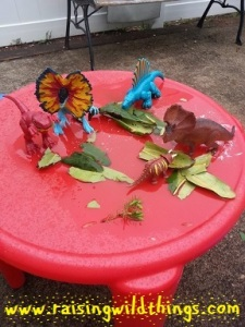 Someone set up his dinosaurs with a little snack outside.