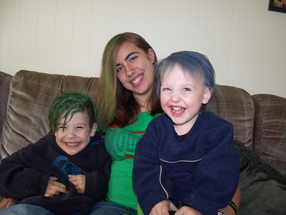 Ange from WA: These are my awesome kids.. Connor 3,  Ashley 15, and Jonny 1. We couldn't play outside with the chalk so we played inside and colored our hair with the chalk :) Aidan aged 12 was at the pool getting rained on. I think we had more fun :)