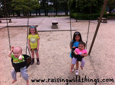 Older sisters + babies in swings = fun!