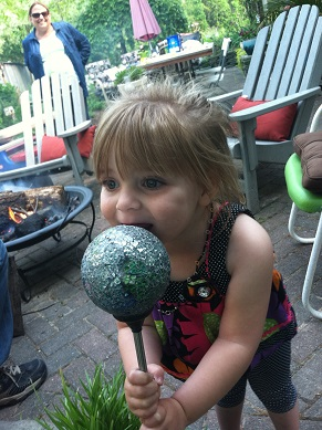 Julianne from MD: My little Diva, in my parents' garden, using a tiny gazing ball as a microphone.