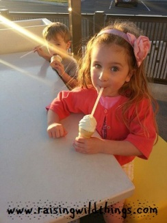 Getting some ice cream while waiting for Daddy's plane to finally land