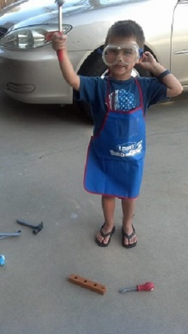 Christi from CA: Her little guy and his tools.