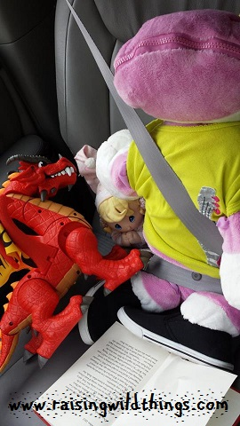 Because the Stuffie, the doll, and the dragon need to be buckled in on the car ride and reading a book.