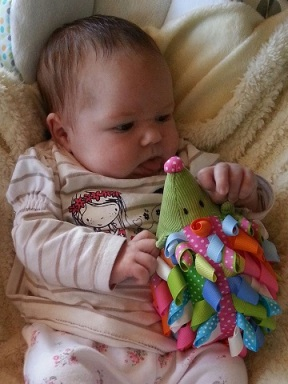 Laura from X: One of my favourite pics of my 5-week-old daughter Evie Marie. It makes me smile as it looks like shes poking her tongue out at her toy hedgehog, either that or shes about to lick its nose!