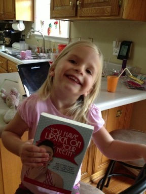 Devan from TN: My baby telling me I have lipstick on my teeth!