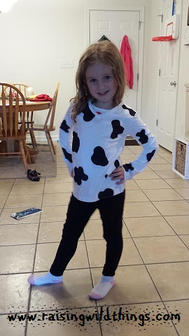 Showing off the shirt I made her for dress-like-a-cow day at school (which was in prep for their spirit night at Chick-fil-A).