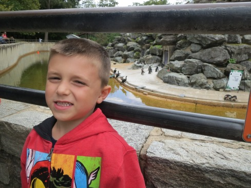 Julianne from MD: My big man with his favorite animals-penguins. At the Maryland Zoo in Baltimore.