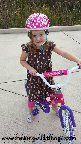 Making goofy faces because she'd rather be riding her bike than posing for pics.