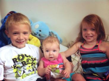 Nicole from IL: Sibling love! Caleb (7 years), Alice (7 months), & Chloe (4 years).