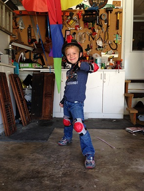 Melissa from MD: My little daredevil modeling his new bike gear.  Gotta protect the noggin' in the coolest way!